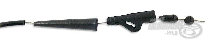Jöhet egy apró gumigolyó, ami lengéscsillapítóként funkcionál bedobás közben. Ez megvédi a főzsinór kötést és az ólomkapocs végét a szétverődéstől